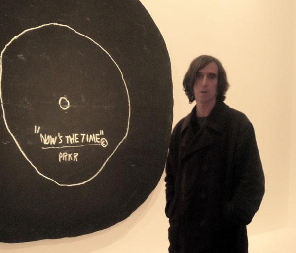 devant un Basquiat